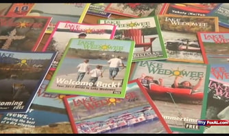 picture of multiple issues of Lake Wedowee Life magazine